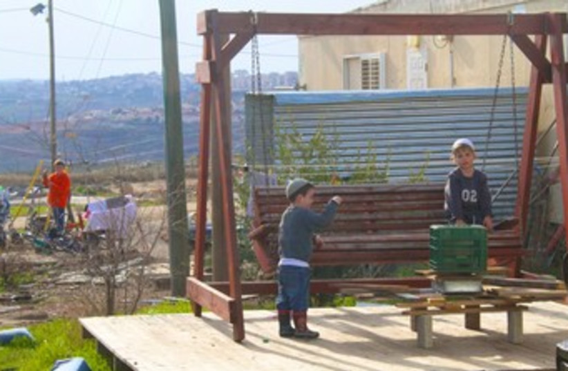 Jewish children play at Migron outpost 370 (photo credit: TOVAH LAZAROFF)