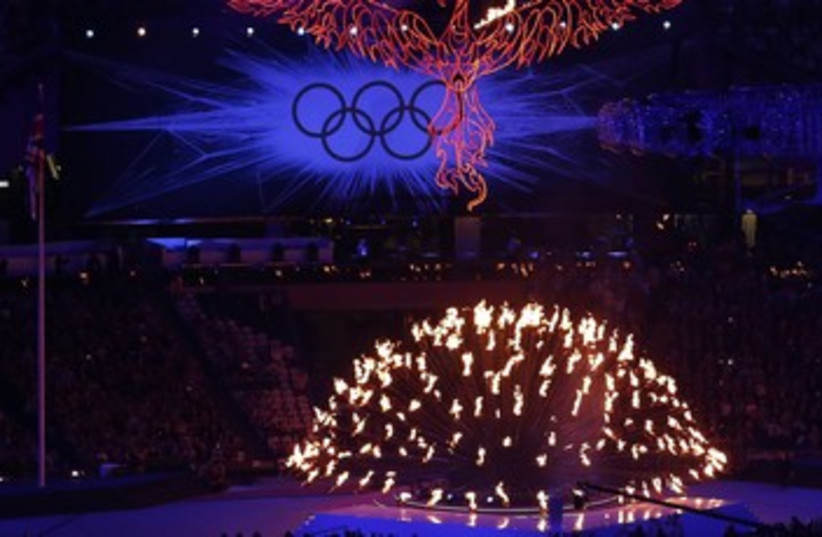 Olympic flame during the closing ceremony 370 (photo credit: Luke MacGregor / Reuters)
