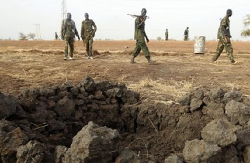 South Sudanese army patrols border 370R (photo credit: Goran Tomasevic/Reuters)