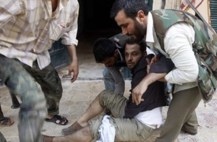 Medics Treat Syria's Wounded (photo credit: Goran Tomasevic / Reuters)