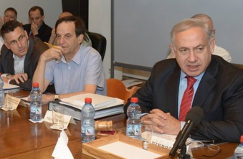 PM Netanyahu at defense budget cabinet meeting 370 (photo credit: GPO / Amos Ben-Gershom)
