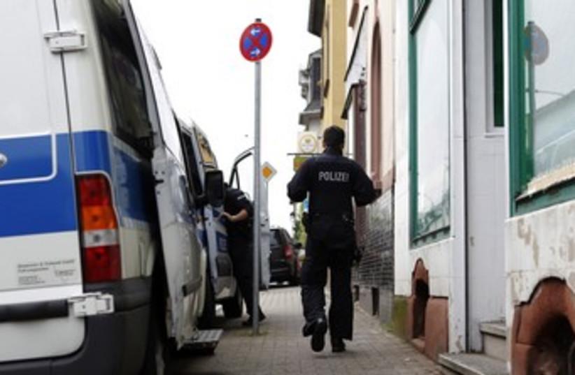 A German police officer 370 (R) (photo credit: Alex Domanski / Reuters)
