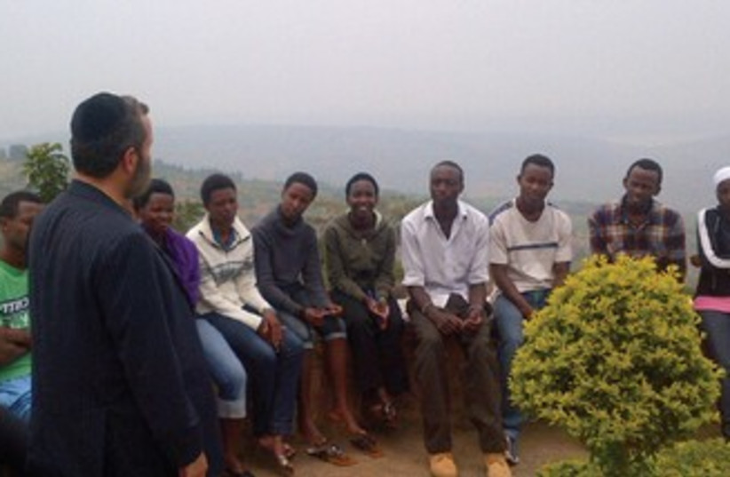 SHMULEY BOTEACH with Rwandan students 370 (photo credit: Courtesy)