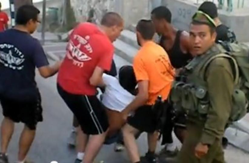 IDF clash Palestinian in Hebron 370 (photo credit: YouTube Screenshot [file)