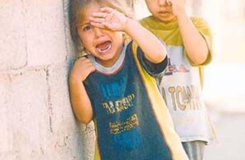 poor kids crying 298.88 (photo credit: Ariel Jerozolimski)