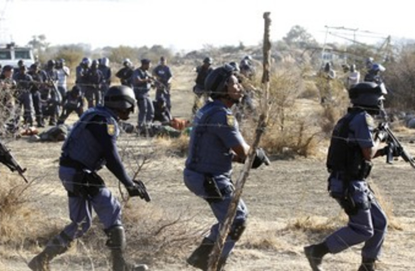 South African police clash with strikers 370 (photo credit: REUTERS)