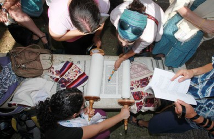 Bird's-eye view of women reading from a Torah scro