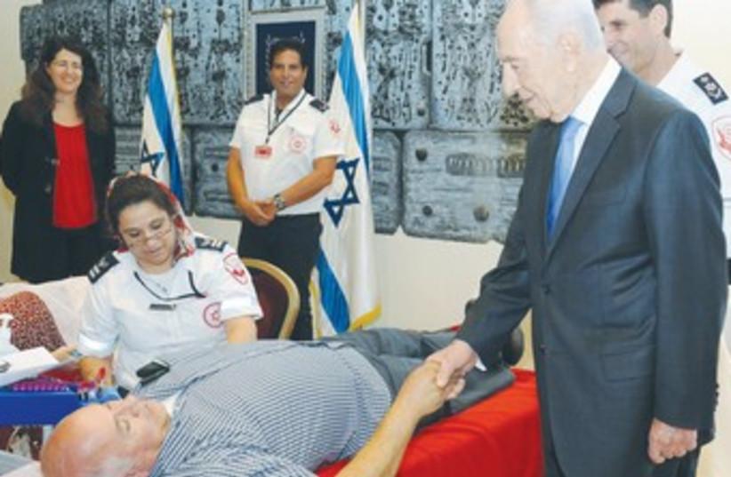 Peres, hospital (photo credit: Mark Neiman/GPO)