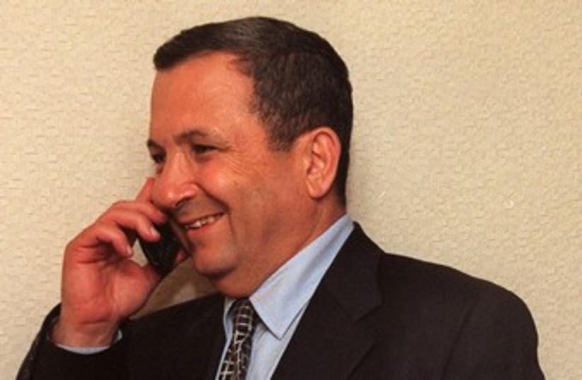 Ehud Barak talks on the phone 370 (photo credit: REUTERS/POOL Old)