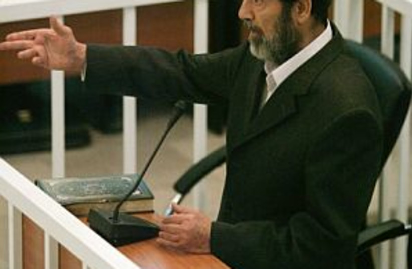 hussein on trial 298 (photo credit: AP)