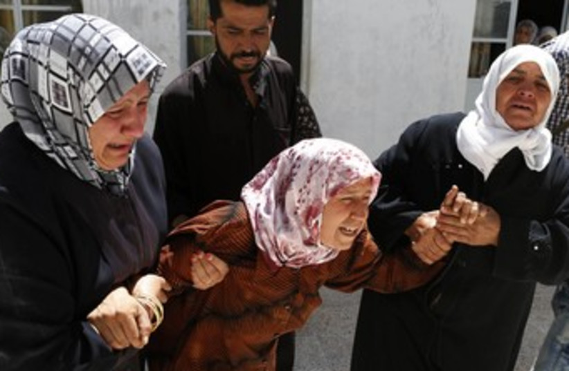 Syria mother crying (R370) (photo credit: REUTERS/Youssef Boudlal)