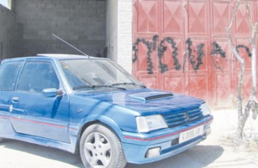 Car damaged in price tag attack 370 (photo credit: Ilene Prusher)