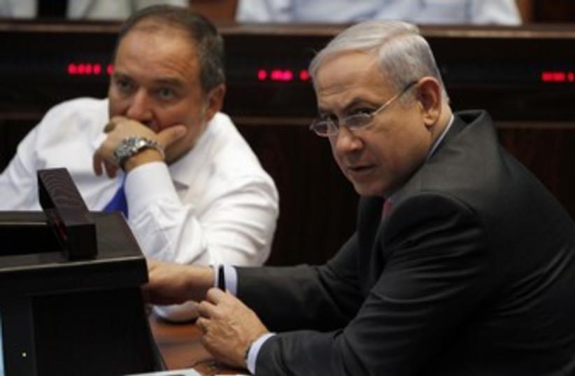 PM Binyamin Netanyahu and FM Avigdor Lieberman 370 (R) (photo credit: Baz Ratner / Reuters)