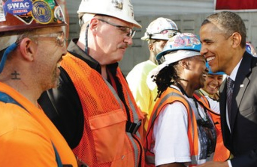 US PRESIDENT Barack Obama greets workers in NY 370 (photo credit: Reuters)