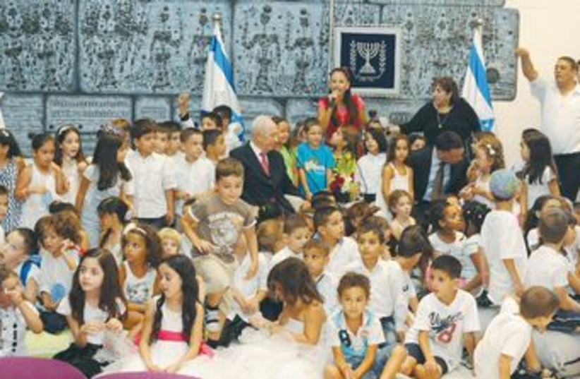President Peres with 120 children 370 (photo credit: GPO)