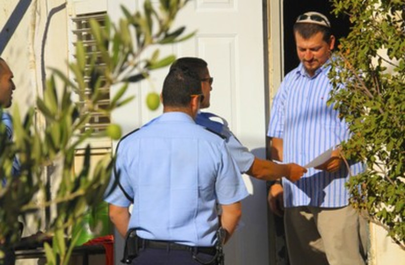 Police hand Migron resident an eviction notice
