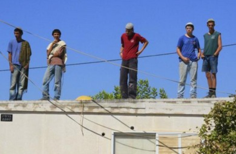 Right wing activists on the rooftop of home