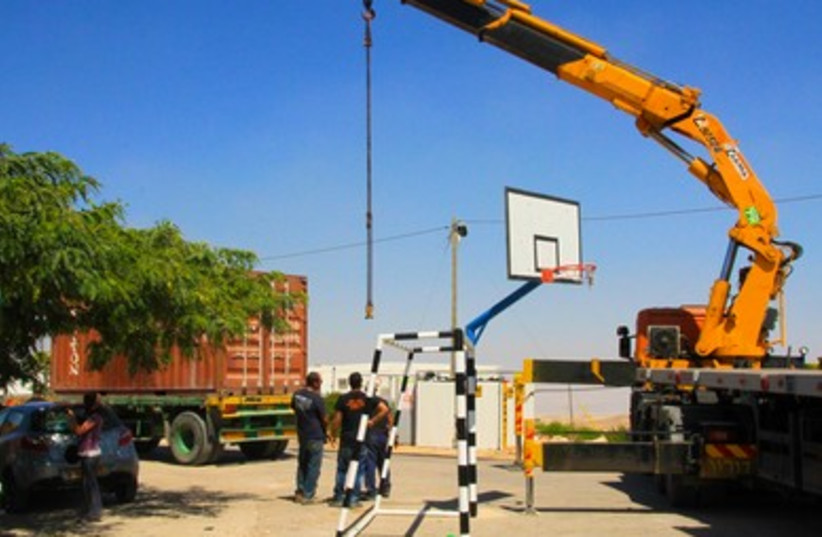Crane operates during evacuation of Migron outpost