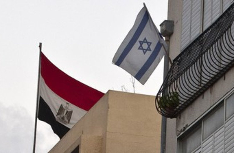 Egyptian flag hangs at embassy in Tel Aviv 370 (photo credit: REUTERS/NIR ELIAS)