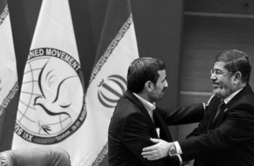 Morsy and Ahmadinejad 370 (photo credit: reuters)