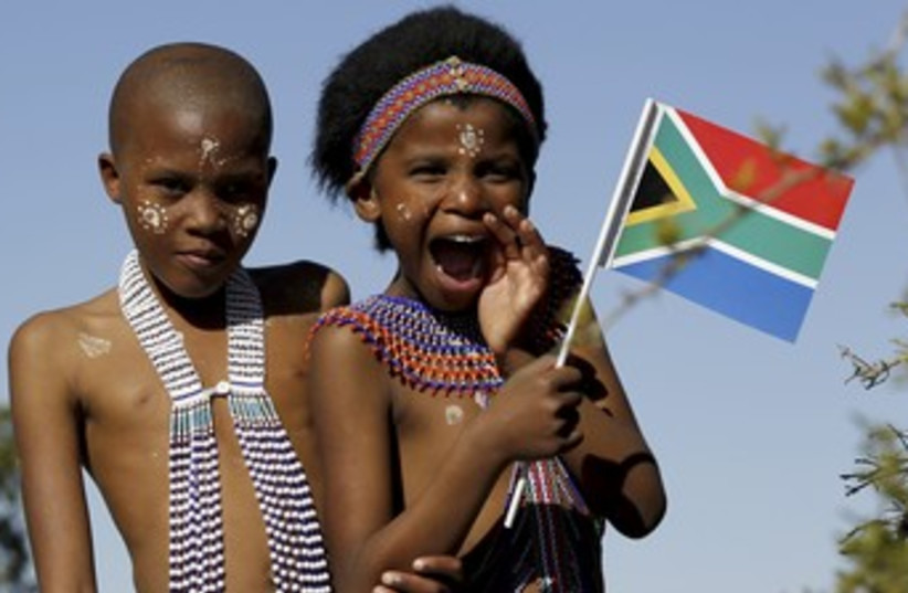 South Africa Flag and Kids (R370) (photo credit: REUTERS/Siphiwe Sibeko)