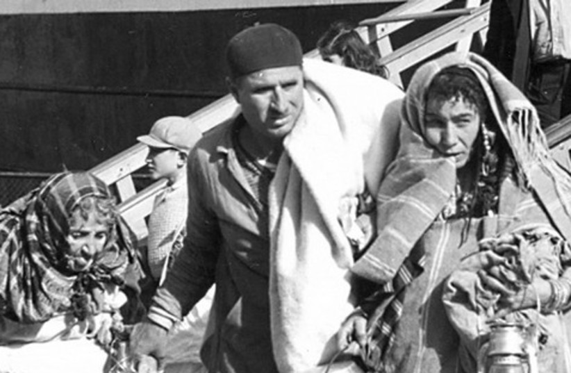 Jewish refugees from Triploi arrive in Haifa 521 (photo credit: Arnold Behr/Jerusalem Post Archives)