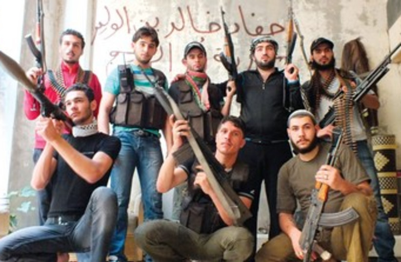 Syrian Rebels in Homs (R370) (photo credit: Yazen Homsy/Reuters)