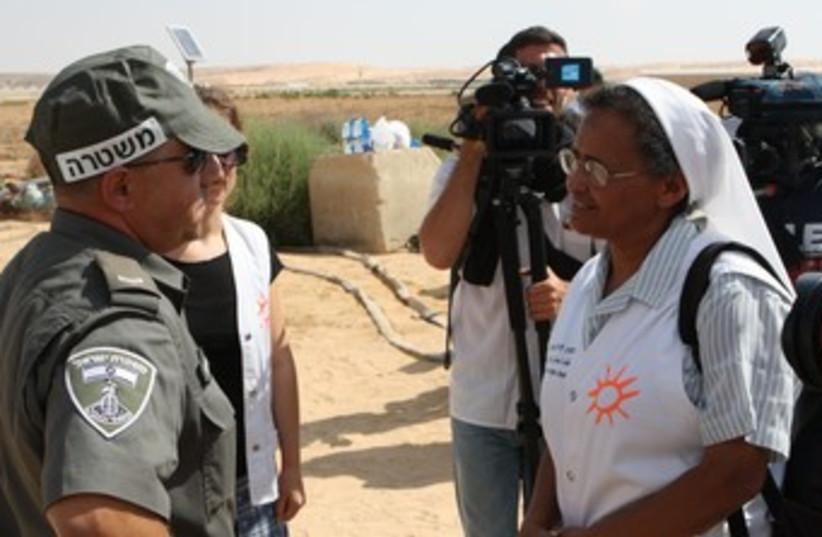 PHR volunteers and security officials near Egypt border 370 (photo credit: Ben Hartman)