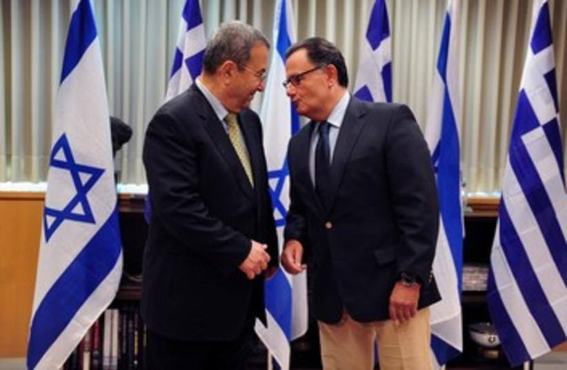 Greek DM Panos Panagiotopoulos with Barak 370 (photo credit: Ariel Harmoni / Defense Ministry)