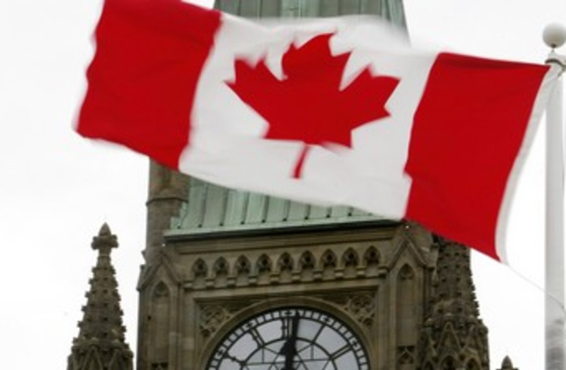Canadian flag at Parliament in Ottawa 370 (photo credit: REUTERS)