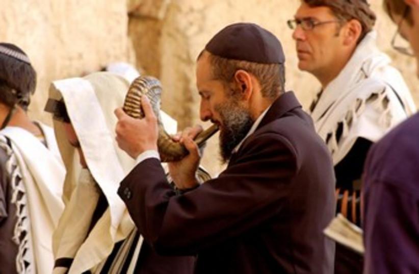 Man blowing shofar (photo credit: BiblePlaces.com)
