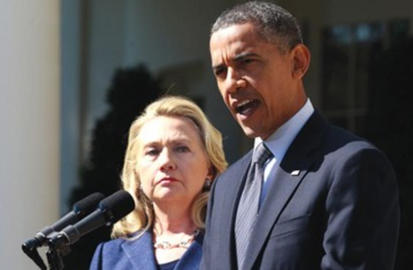 Hillary Clinton and Barack Obama tough 390 (photo credit: Jason Reed/Reuters)