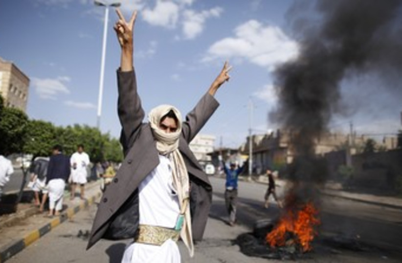 Protests outside US Embassy in Sanaa, Yemen 370 (R) (photo credit: Khaled Abdullah Ali Al Mahdi / Reuters)