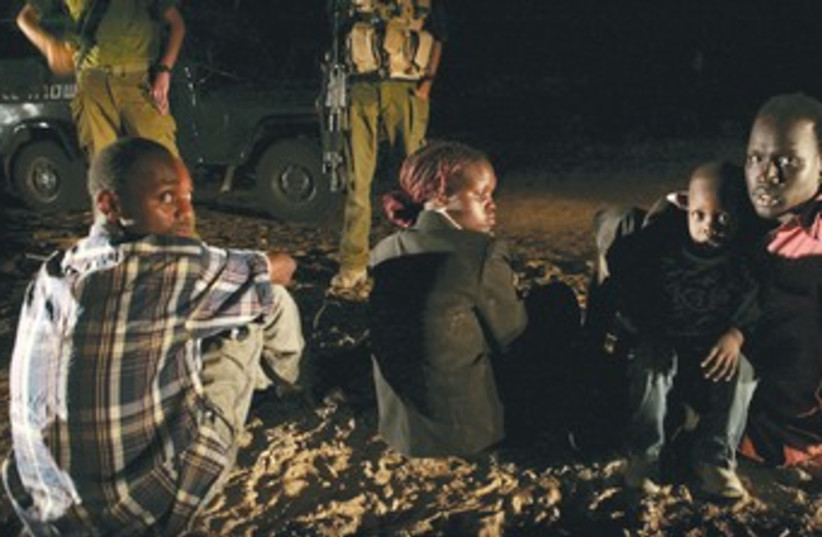 IDF watch over Sudanese migrants R370 (photo credit: Yonathan Weitzman/Reuters)