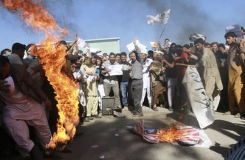 Protesters burn US flag in Afghanistan 390 (photo credit: REUTERS)