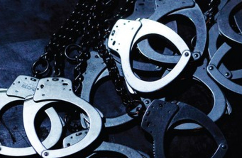 Handcuffs (illustrative photo) 370 (photo credit: Reuters)