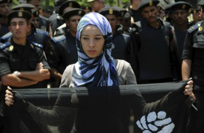 Egyptian woman protests in Cairo 370 (photo credit: REUTERS/Mohamed Abd El Ghany)