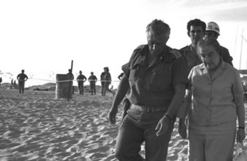 Golda Meir, Ariel Sharon walk in Sinai in 1973 370 (photo credit: REUTERS/Handout )
