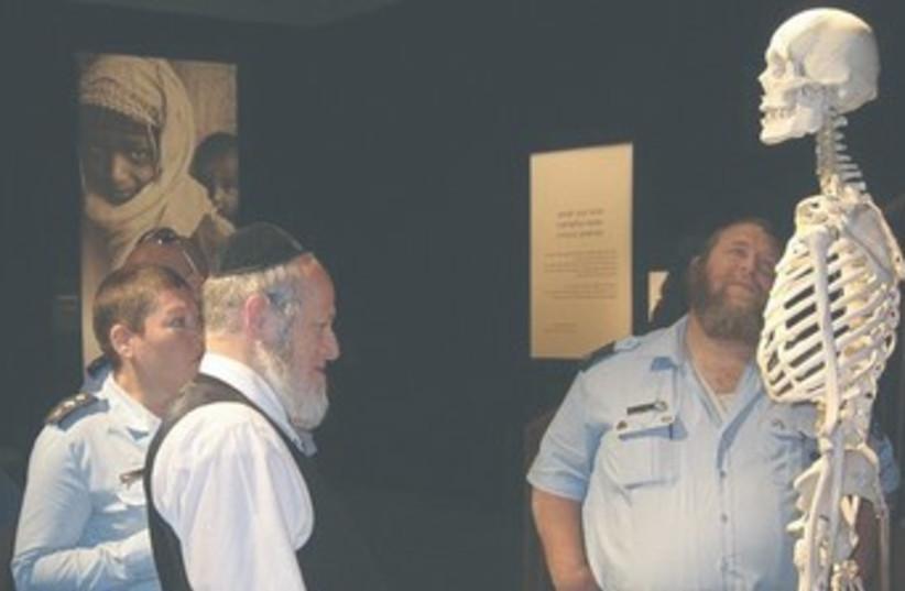 Religious Jews observe Bodies exhibit 370 (photo credit: Courtesy ZAKA)