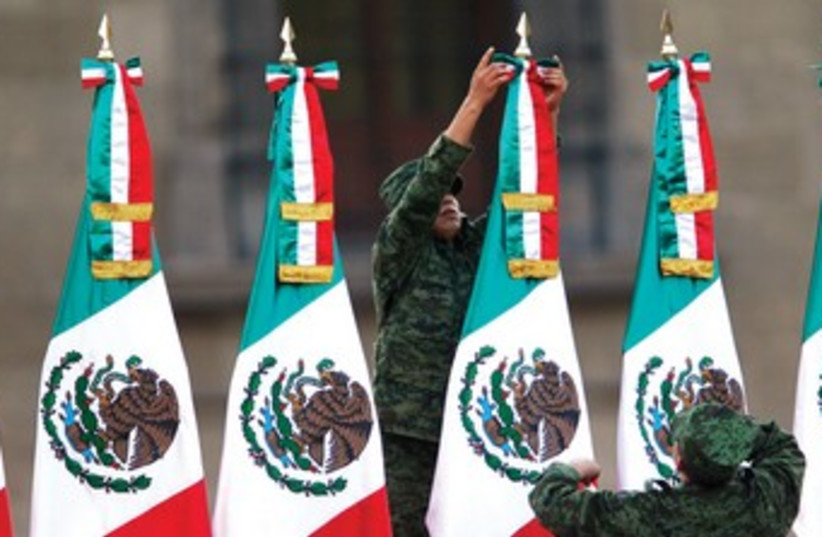 Soldiers Mexican flags 370 (photo credit: Tomas Bravo/Reuters)