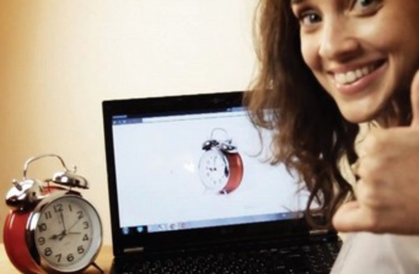 Laptop and Clock 370 (photo credit: RotaryView)