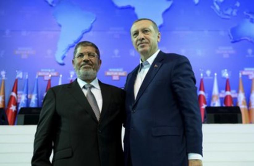 Morsy and Erdogan (photo credit: REUTERS)