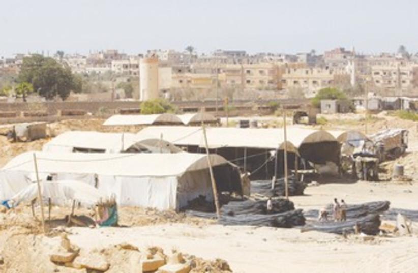 Gazans collect metal smuggled through tunnels 370 (R) (photo credit: Ibraheem Abu Mustafa/Reuters)