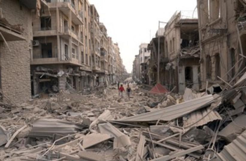 Scene of blasts in Syria's Aleppo 370 (R) (photo credit: Sana / Reuters)
