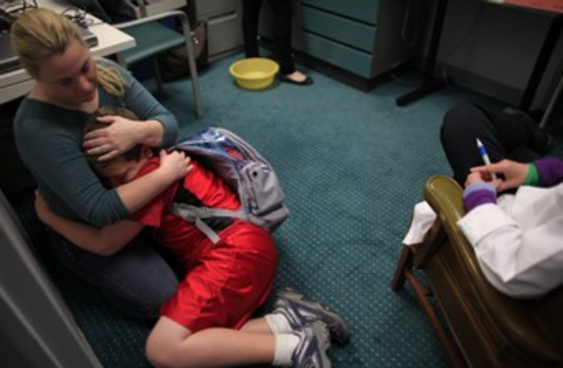 Sick child (photo credit: Reuters)