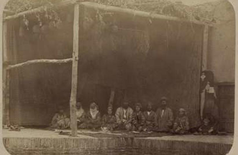 Jews sitting in their Samarkand Sukka (circa 1870)