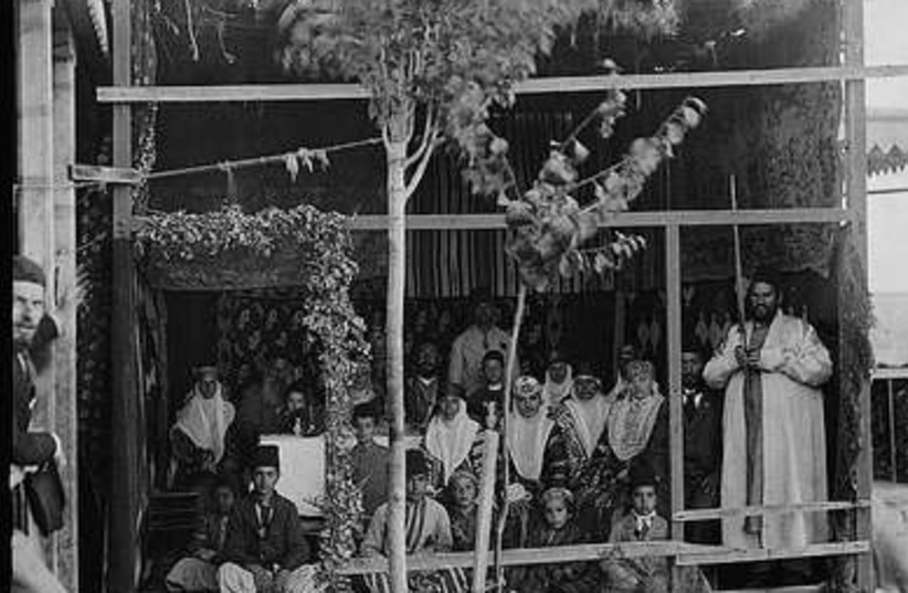 Bukharan family in their Jerusalem sukka (circa 19