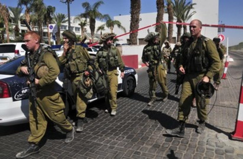 IDF soldiers guard the area near Eilat hotel 390 (photo credit: REUTERS)