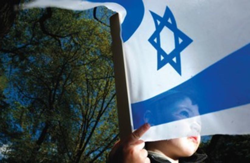 Child with Israel flag 370 (photo credit: Courtesy)
