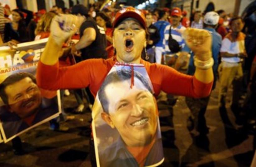 Supporters of Venezuela's Hugo Chavez celebrate 370 (R) (photo credit: Jorge Silva / Reuters)